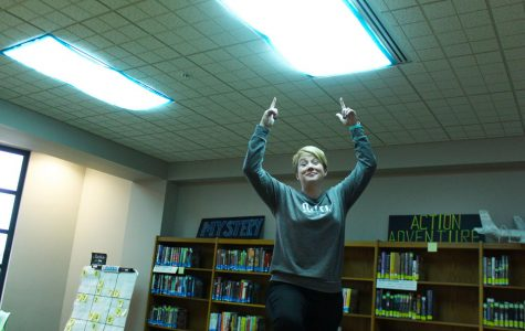 Librarian Julie Huff proudly presents her blue light covers in the student area of the library.