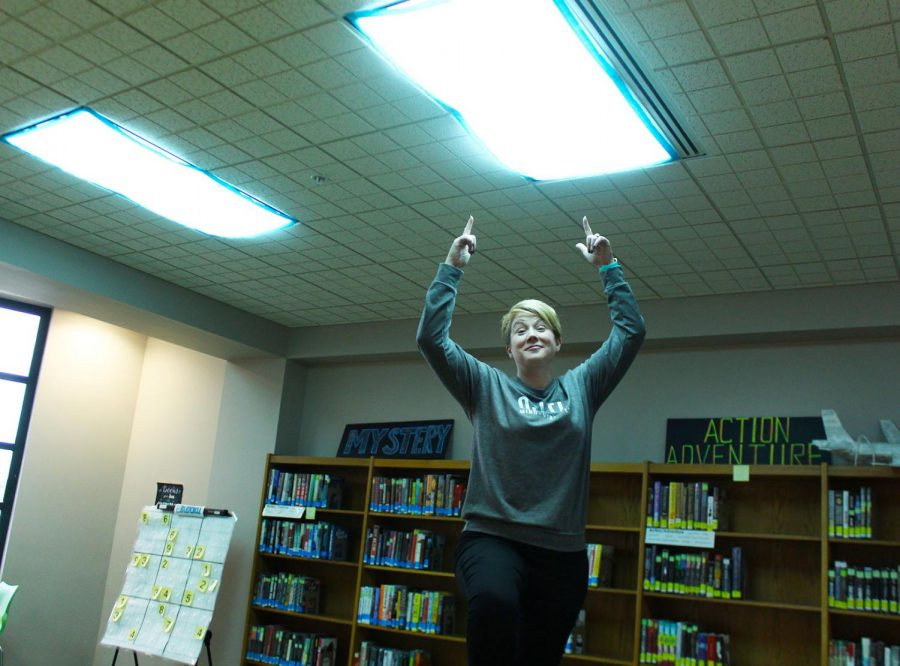 Librarian+Julie+Huff+proudly+presents+her+blue+light+covers+in+the+student+area+of+the+library.