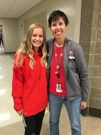 Riann Lubinski and sophomore Alicen Ashley pose for a picture.  The first year that the COC had an official Cross Country Championship, Lubinksi won the girls varsity race.  The next Nixa girl to win a COC championship was this past season when Alicen Ashley won.