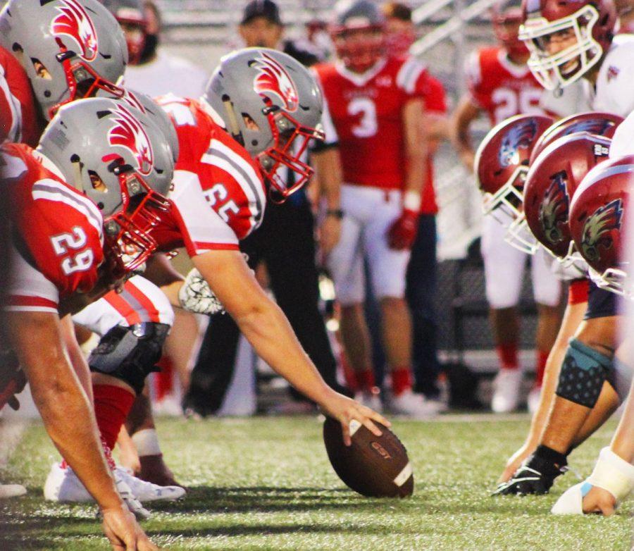 Nixa+Eagles+center+prepares+to+snap+the+football+to+his+quarterback.