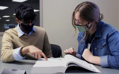 Juniors Lauren Tiffin and Eshan Jain study for upcoming tests, trying to predict what will be different because of the coronavirus.