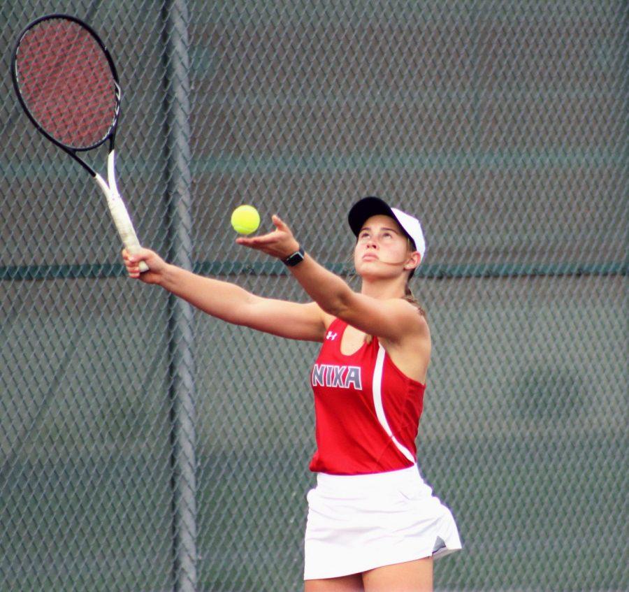 Lauren Reed serves the ball.