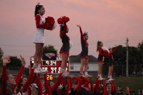 As kickoff happens, the cheerleaders start the game off by spiriting and pumping up the crowd.