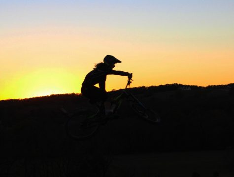 Seniors Aaron Coorts and Rylan Miller ride their bikes at Two Rivers Mountain Bike Park in Jamesville, MO.