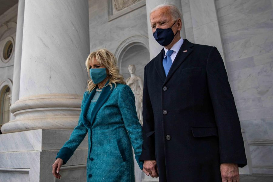 President Joseph R. Biden Jr. moves into position alongside his wife, Jill Biden.