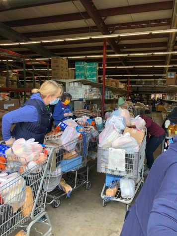 Least of These volunteers quickly bag and load groceries to feed those with food insecurity during the COVID-19 pandemic.