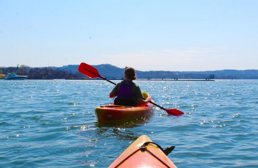Junior Kelsey Cook kayaks on Table Rock Lake in Missouri.