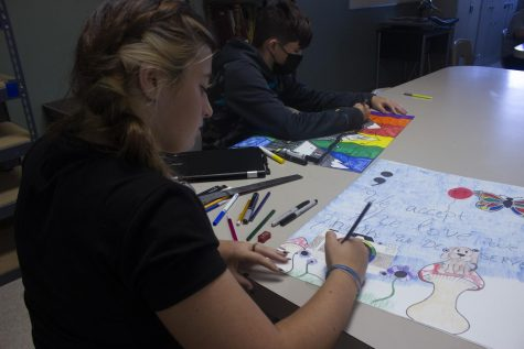 """The Art Foundations class at Nixa High School, works on their drawing skills. Face masks became optional during summer school. In the art room students were excited to get their drawing on.  """"In this class my favorite is to draw,"""" Abigail Muniz said."""