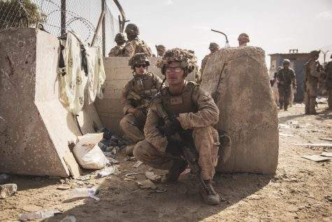 U.S. Marines with Special Purpose Marine Air-Ground Task Force - Crisis Response - Central Command, take a moment to rest during an evacuation at Hamid Karzai International Airport, Kabul Afghanistan, Aug. 21.