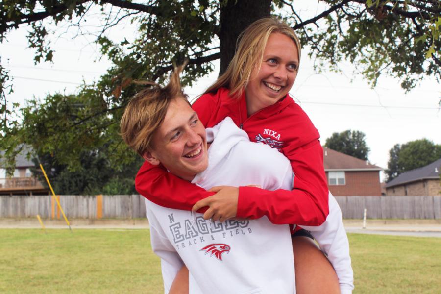 Senior Emily Harris jumps onto freshman Payton Harris back. I view everything we do together as a gift, Harris said.